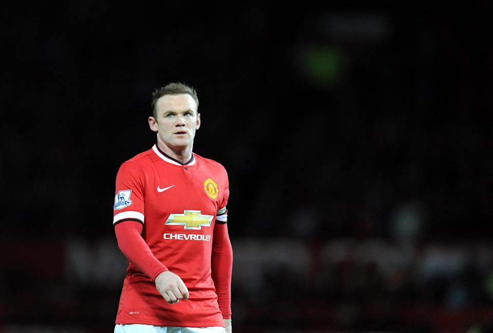 Gary Neville wants to see former team-mate Wayne Rooney restored to the attack from midfield (AFP Photo/Oli Scarff)