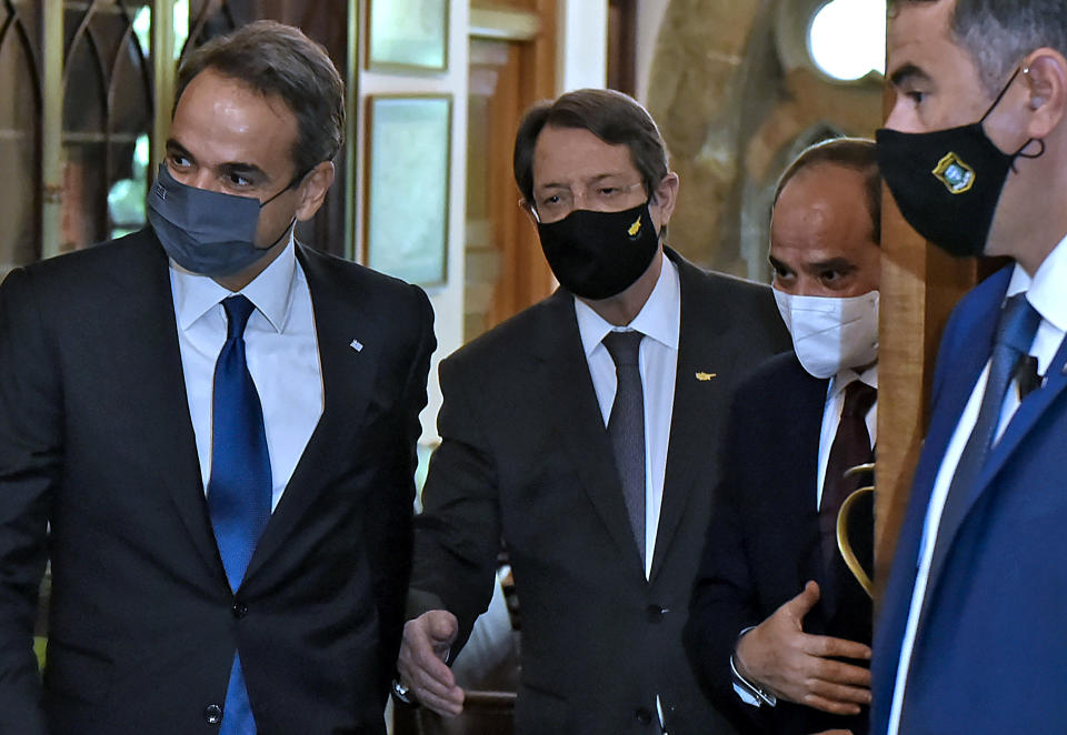 Cyprus President Nicos Anastasiades, center, Greece's Prime minister Kyriakos Mitsotakis, left, and Egypt's President Abdel-Fattah el-Sissi, center right, are seen before their meeting at the presidential palace in capital Nicosia, Cyprus, on Wednesday, Oct. 21, 2020. The leaders of Cyprus, Egypt and Greece meet in the Cypriot capital for talks on forging closer ties and boosting cooperation on issues including energy following the discovery of gas deposits in the east Mediterranean. (Iakovos Hatzistavrou Pool via AP)