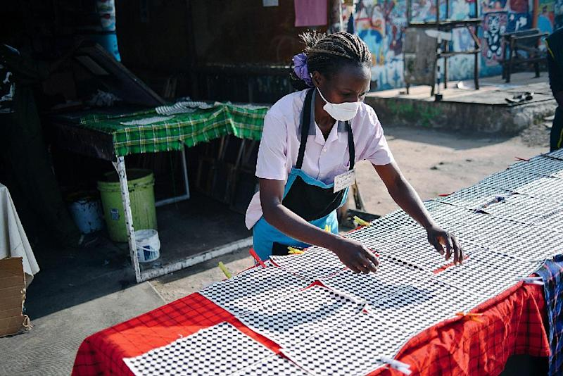 A woman works in Nairobi's Hub workshop, the heart of Ethical Fashion Africa, a not-for-profit group, June 19, 2014 (AFP Photo/Tahir Karmali)