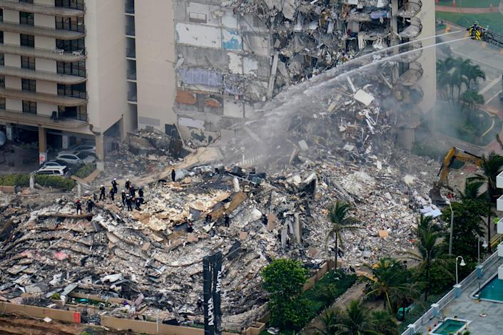 Rescue workers work in the rubble at the Champlain Towers South Condo is seen, Friday, June 25, 2021, in Surfside.
