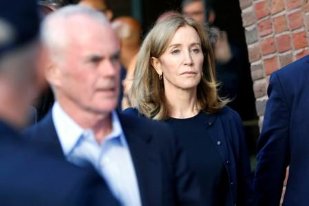 Actress Felicity Huffman and husband William H. Macy leave the federal courthouse in Boston