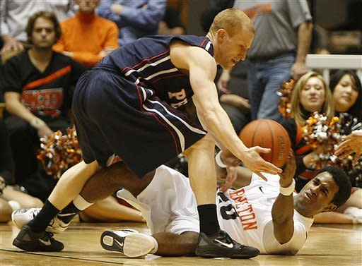 Pennsylvania's Zack Rosen, left, steals the ball away from Princeton's Douglas Davis during the first half of an NCAA college basketball game in Princeton, N.J. on Tuesday, March 6, 2012. (AP Photo/Tim Larsen)