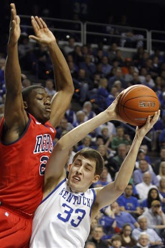 Kentucky's Kyle Wiltjer (33) is pressured by Mississippi's Reginald Buckner during the first half of an NCAA college basketball game in Lexington, Ky., Saturday, Feb. 18, 2012. (AP Photo/James Crisp)