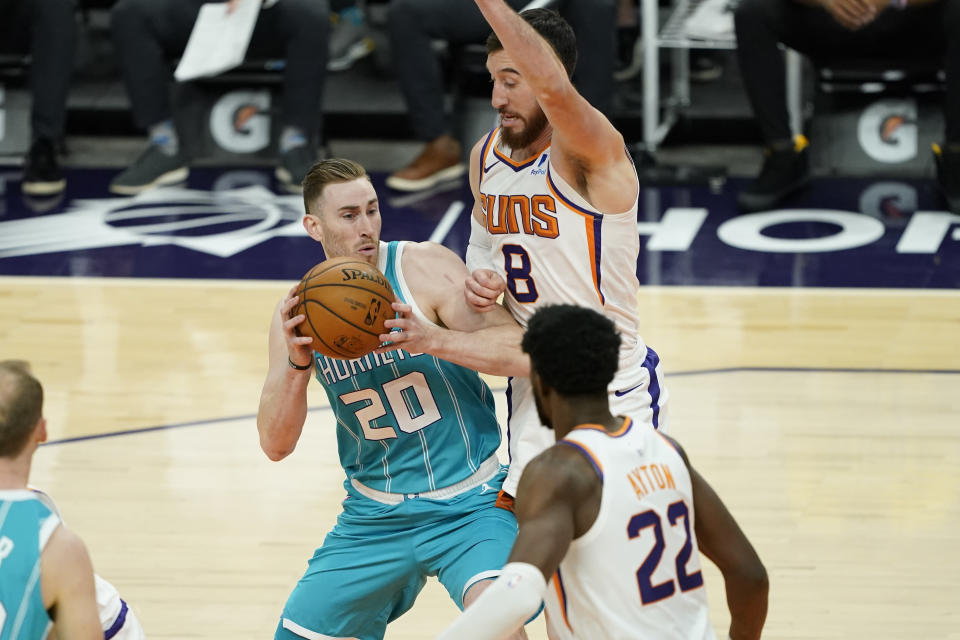 Charlotte Hornets forward Gordon Hayward (20) drives on Phoenix Suns forward Frank Kaminsky (8) during the first half of an NBA basketball game, Wednesday, Feb. 24, 2021, in Phoenix. (AP Photo/Matt York)