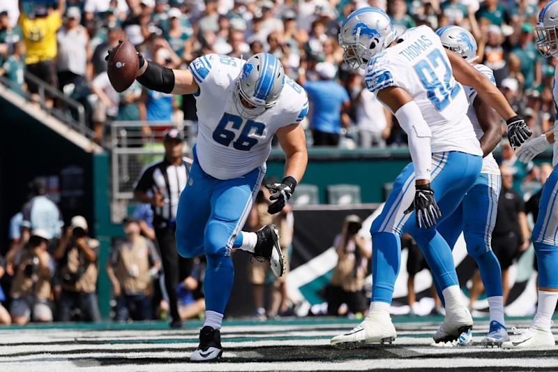 Joe Dahl spikes the ball after a Detroit Lions touchdown during the first half against the Philadelphia Eagles, Sept. 22, 2019, in Philadelphia.