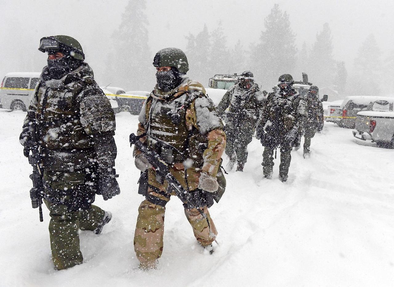 A San Bernardino County Sheriff SWAT team returns to the command post at Bear Mountain near Big Bear Lake, Calif. after searching for Christopher Jordan Dorner on Friday, Feb. 8, 2013. Search conditions have been hampered by a heavy winter storm in the area. Dorner, a former Los Angeles police officer, is accused of carrying out a killing spreebecause he felt he was unfairly fired from his job. (AP Photo/The Inland Valley Daily Bulletin, Will Lester, Pool)