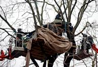 Enforcement agents dismantle a makeshift camp of Extinction Rebellion activists who demonstrate on a tree as others occupy tunnels under Euston Square Gardens, to protest against the HS2 high-speed railway in London, Britain, January 27, 2021. REUTERS/Hannah McKay