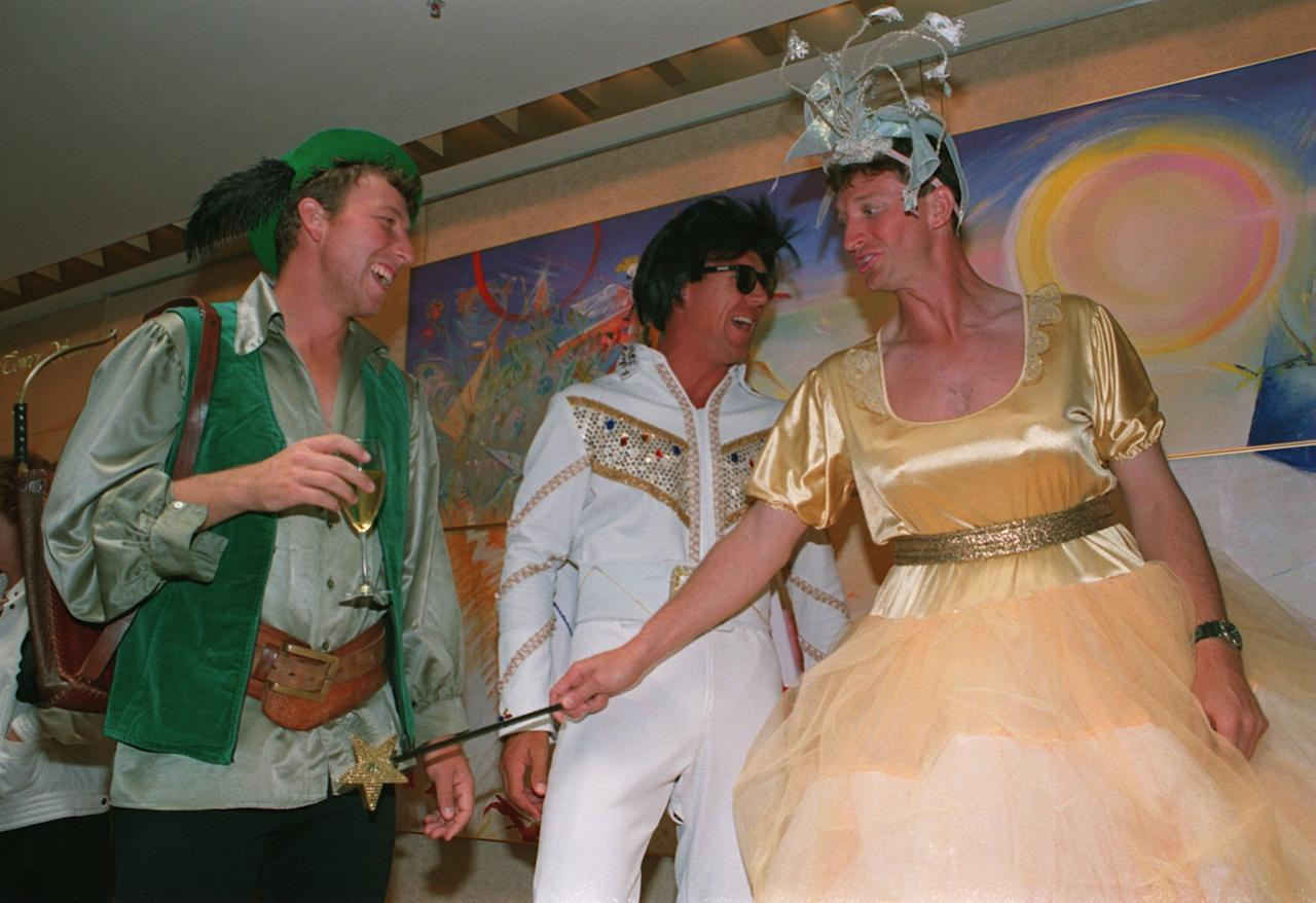 25 DEC 1994:  ENGLAND CAPTAIN MIKE ATHERTON ALEC STEWART & PHYSIO DAVE ROBERTS (RIGHT) ARE DRESSED UP IN FANCY DRESS FOR THE CHRISTMAS PARTY DURING THE SECOND TEST AGAINST AUSTRALIA IN MELBOURNE. Mandatory Credit: Graham Chadwick/ALLSPORT