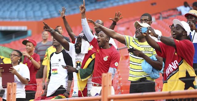Soccer fans cheer for the Ghana National team as it plays South Korea during the first half of an international friendly soccer match in Miami Gardens, Fla., Monday, June 9, 2014. ( AP Photo/J Pat Carter)
