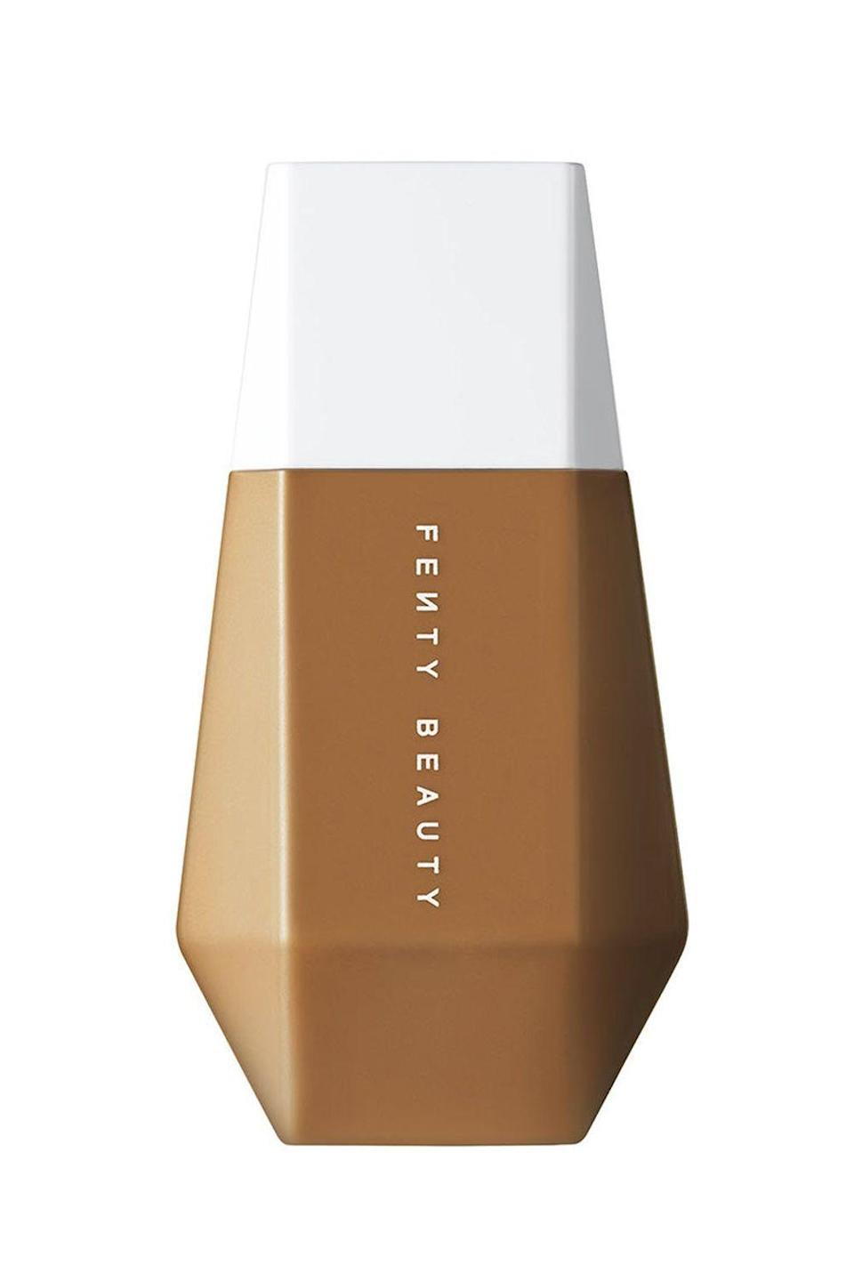 """<p><strong>FENTY BEAUTY by Rihanna</strong></p><p>sephora.com</p><p><strong>$29.50</strong></p><p><a href=""""https://go.redirectingat.com?id=74968X1596630&url=https%3A%2F%2Fwww.sephora.com%2Fproduct%2Ffenty-beauty-rihanna-eaze-drop-blurring-skin-tint-P470025&sref=https%3A%2F%2Fwww.cosmopolitan.com%2Fstyle-beauty%2Fbeauty%2Fg36094404%2Fbest-skin-tints%2F"""" rel=""""nofollow noopener"""" target=""""_blank"""" data-ylk=""""slk:Shop Now"""" class=""""link rapid-noclick-resp"""">Shop Now</a></p><p>Leave it to RiRi to create a skin tint that's nothing short of magic. It <strong>comes in 25 shades (finding your perfect color match = NBD)</strong>, blurs the redness and <a href=""""https://www.cosmopolitan.com/style-beauty/beauty/a35325966/how-to-treat-hyperpigmentation-deep-skin/"""" rel=""""nofollow noopener"""" target=""""_blank"""" data-ylk=""""slk:hyperpigmentation"""" class=""""link rapid-noclick-resp"""">hyperpigmentation</a>, smooth rough texture, and has a flexible finish that won't settle into pores or fine lines.</p>"""