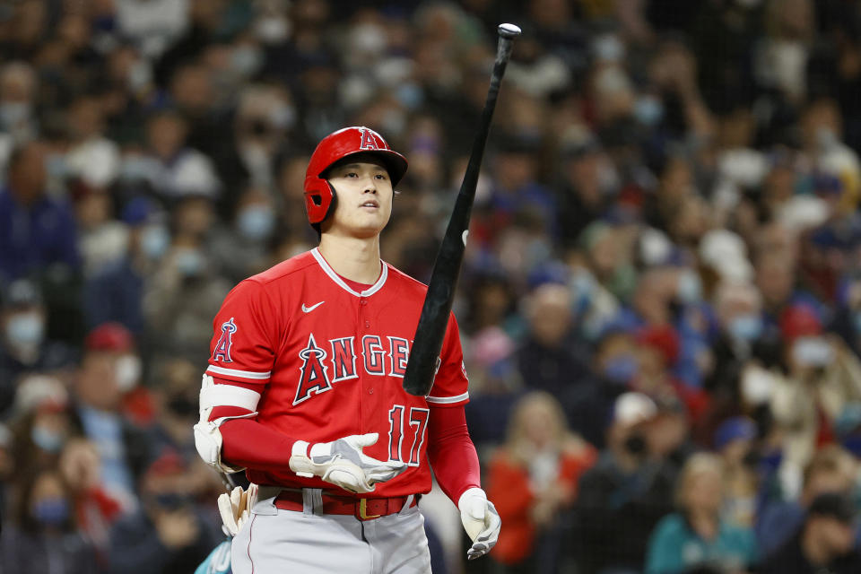 SEATTLE, WASHINGTON - OCTOBER 01: Shohei Ohtani #17 of the Los Angeles Angels flips his bat after he was walked during the third inning against the Seattle Mariners at T-Mobile Park on October 01, 2021 in Seattle, Washington. (Photo by Steph Chambers/Getty Images)