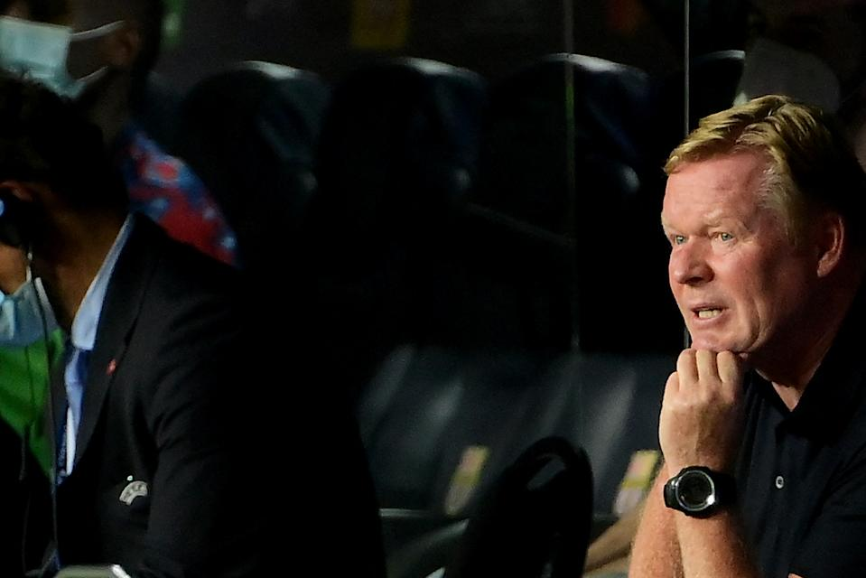 Barcelona's Dutch coach Ronald Koeman reacts during the UEFA Champions League first round group E football match between Barcelona and Bayern Munich at the Camp Nou stadium in Barcelona on September 14, 2021. (Photo by LLUIS GENE / AFP) (Photo by LLUIS GENE/AFP via Getty Images)
