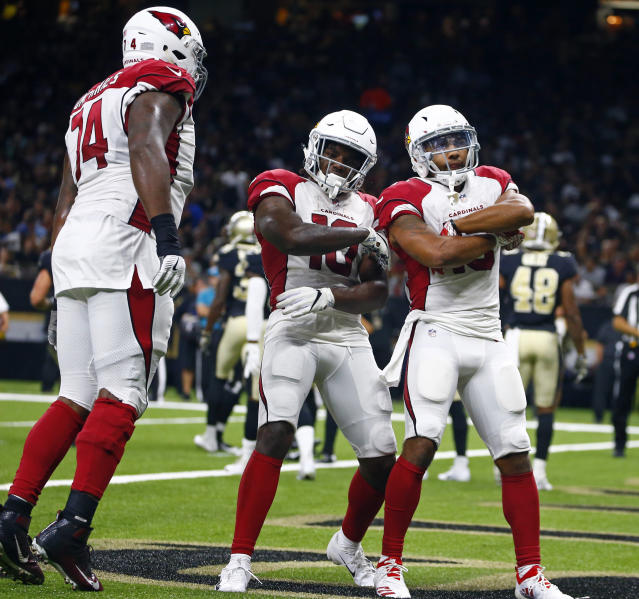 Arizona Cardinals wide receiver Christian Kirk, right, celebrates his touchdown reception with wide receiver Chad Williams (10) and offensive tackle D.J. Humphries (74) in the first half of an NFL preseason football game in New Orleans, Friday, Aug. 17, 2018. (AP Photo/Butch Dill)
