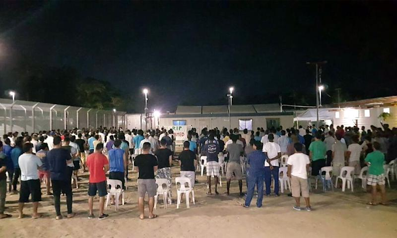 Refugees and asylum seekers holding a vigil for an asylum seeker who was found dead on Manus Island