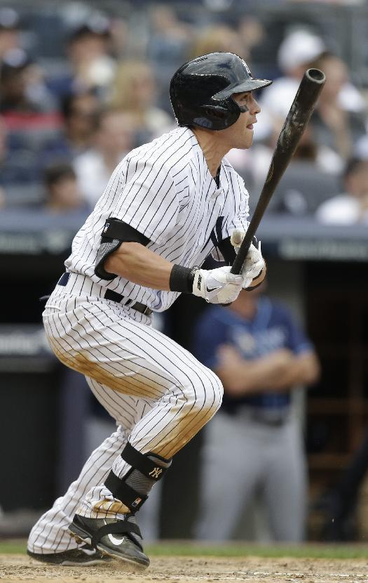 New York Yankees' Jacoby Ellsbury follows through on a ground-rule double to drive in a run during the fifth inning of a baseball game against the Tampa Bay Rays Saturday, May 3, 2014, in New York. (AP Photo/Frank Franklin II)
