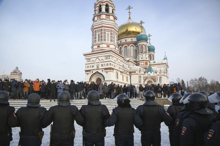 Police stand guard during a protest against the jailing of opposition leader Alexei Navalny in Siberian city of Omsk, Russia, Saturday, Jan. 23, 2021. Russian police on Saturday arrested hundreds of protesters who took to the streets in temperatures as low as minus-50 C (minus-58 F) to demand the release of Alexei Navalny, the country's top opposition figure. Navalny, President Vladimir Putin's most prominent foe, was arrested on Jan. 17 when he returned to Moscow from Germany, where he had spent five months recovering from a severe nerve-agent poisoning that he blames on the Kremlin. (AP Photo)