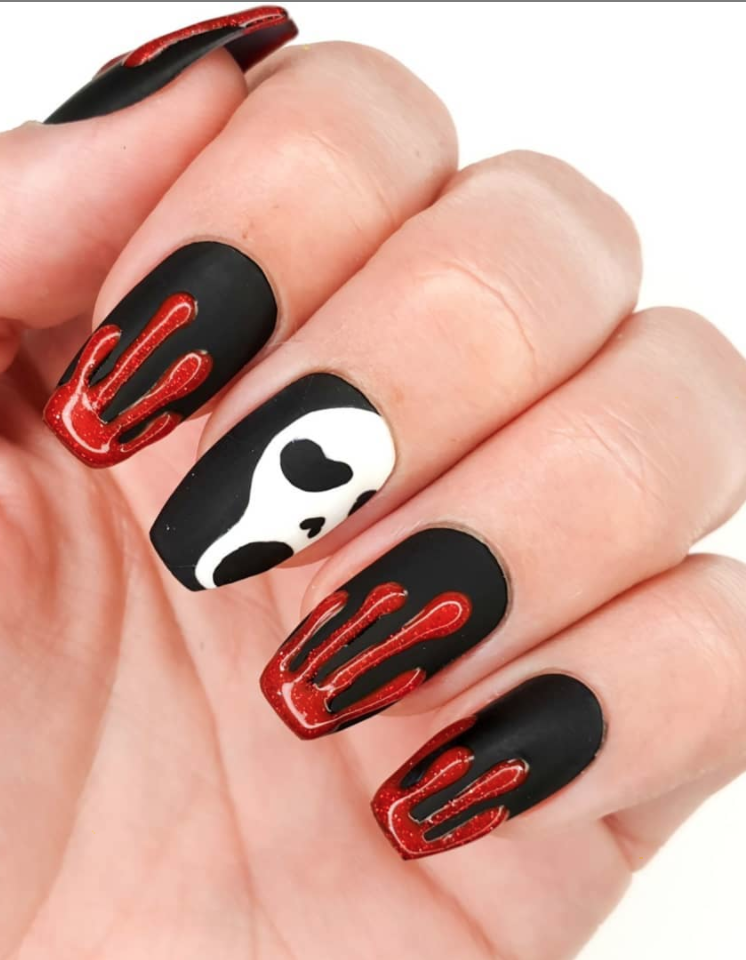 """<p>Start with a black nail polish, and layer a matte top coat over it to get the base for this scream-worthy design by <a href=""""https://www.instagram.com/p/B347fyMAU9z/"""" rel=""""nofollow noopener"""" target=""""_blank"""" data-ylk=""""slk:nail artist and blogger Ceri."""" class=""""link rapid-noclick-resp"""">nail artist and blogger Ceri.</a></p><p><a class=""""link rapid-noclick-resp"""" href=""""https://go.redirectingat.com?id=74968X1596630&url=https%3A%2F%2Fwww.etsy.com%2Flisting%2F774790412%2Fvegan-nail-polish-matte-coat-the-matte&sref=https%3A%2F%2Fwww.oprahmag.com%2Fbeauty%2Fskin-makeup%2Fg33239588%2Fhalloween-nail-ideas%2F"""" rel=""""nofollow noopener"""" target=""""_blank"""" data-ylk=""""slk:SHOP MATTE TOP COAT"""">SHOP MATTE TOP COAT</a></p>"""