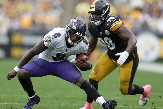 Baltimore Ravens quarterback Lamar Jackson (8) scrambles away from Pittsburgh Steelers inside linebacker Vince Williams (98) in the second half of an NFL football game, Sunday, Oct. 6, 2019, in Pittsburgh. (AP Photo/Don Wright)