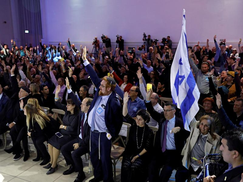Likud party members vote during a Likud Central Committee meeting in Airport City, Israel December 31, 2017: REUTERS/Amir Cohen