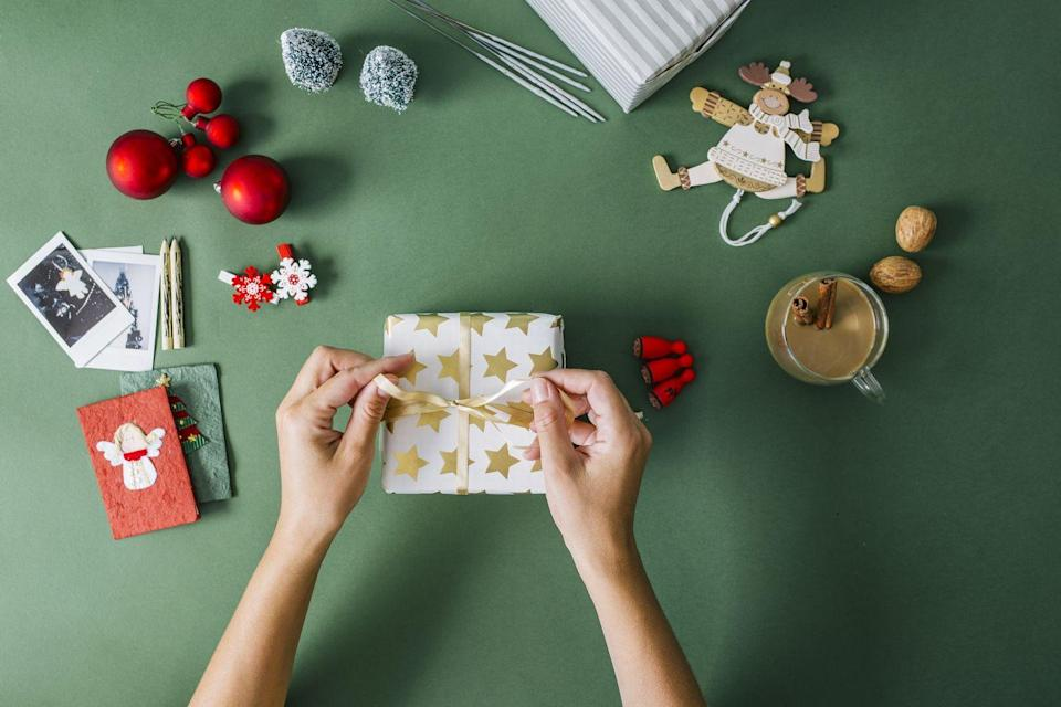 """<p>Here's something that'll test family bonds: Divide in to teams of two, and see who can wrap a gift — neatly! — the fastest. The twist? Each person has to have one arm behind their back. Teamwork!</p><p><strong>RELATED:</strong> <a href=""""https://www.goodhousekeeping.com/holidays/gift-ideas/tips/g1775/diy-holiday-gift-wrap/"""" rel=""""nofollow noopener"""" target=""""_blank"""" data-ylk=""""slk:45 Easy Gift Wrapping Ideas to Give Your Presents That Extra Sparkle"""" class=""""link rapid-noclick-resp"""">45 Easy Gift Wrapping Ideas to Give Your Presents That Extra Sparkle</a></p>"""