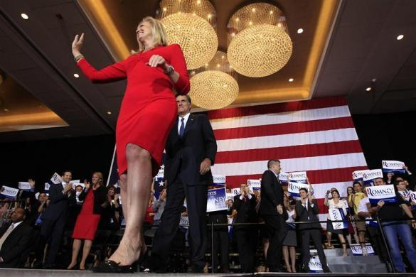 Mitt Romney and his wife Ann arrive for his Illinois primary night rally in Schaumburg, Illinois, March 20, 2012.