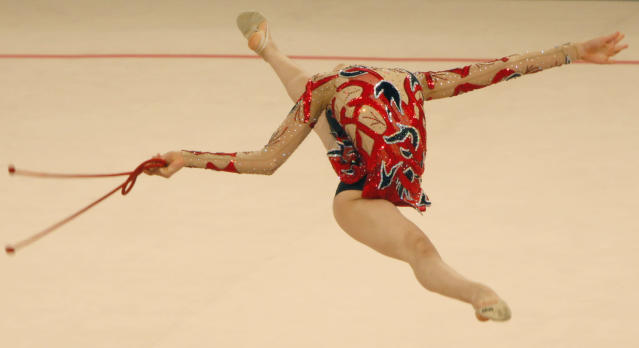 Yasmine Mohamed Rosto of Egypt performs with a skipping-rope at the rhythmic gymnastics World Cup 2009 tournament, in Ukraine's capital Kiev, Friday, Aug. 14, 2009. (AP Photo / Efrem Lukatsky)