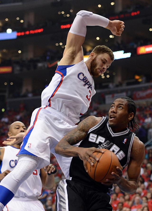 LOS ANGELES, CA - MAY 20: Kawhi Leonard #2 of the San Antonio Spurs looks to shoot against Blake Griffin #32 of the Los Angeles Clippers in the first quarter in Game Four of the Western Conference Semifinals in the 2012 NBA Playoffs on May 20, 2011 at Staples Center in Los Angeles, California. NOTE TO USER: User expressly acknowledges and agrees that, by downloading and or using this photograph, User is consenting to the terms and conditions of the Getty Images License Agreement. (Photo by Harry How/Getty Images)