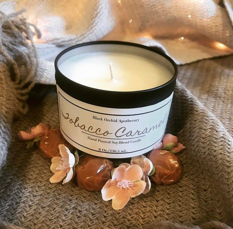 """<p><strong>Blk Orchid Apothecary</strong></p><p>etsy.com</p><p><strong>$15.00</strong></p><p><a href=""""https://go.redirectingat.com?id=74968X1596630&url=https%3A%2F%2Fwww.etsy.com%2Flisting%2F720085339%2Ftobacco-caramel-candle&sref=https%3A%2F%2Fwww.oprahmag.com%2Flife%2Fg27562264%2Fbest-fall-scented-candles%2F"""" rel=""""nofollow noopener"""" target=""""_blank"""" data-ylk=""""slk:Shop Now"""" class=""""link rapid-noclick-resp"""">Shop Now</a></p><p>Rustic, cozy aromas of orange, oak, musk, and patchouli are packed into this handmade candle. </p>"""