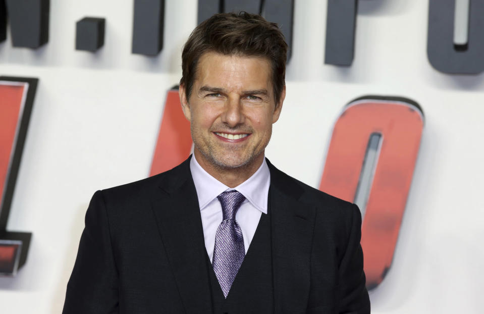 """FILE - Tom Cruise arrives at the premiere of the """"Mission: Impossible - Fallout"""" in London on July 13, 2018. Paramount Pictures has shut down shooting on the British set of Tom Cruise's seventh """"Mission: Impossible"""" film after someone tested positive for coronavirus. A Paramount spokesman says Thursday, June 3, 2021, that due to a positive result during routine testing, the set will be shut down until June 14. Paramount says it is following safety protocols and will continue to monitor the situation. The company provided no further details. The film, which paused production for months early last year along with the rest of the film industry when the coronavirus pandemic took hold, is scheduled to be released in 2022. (Photo by Grant Pollard/Invision/AP, File)"""