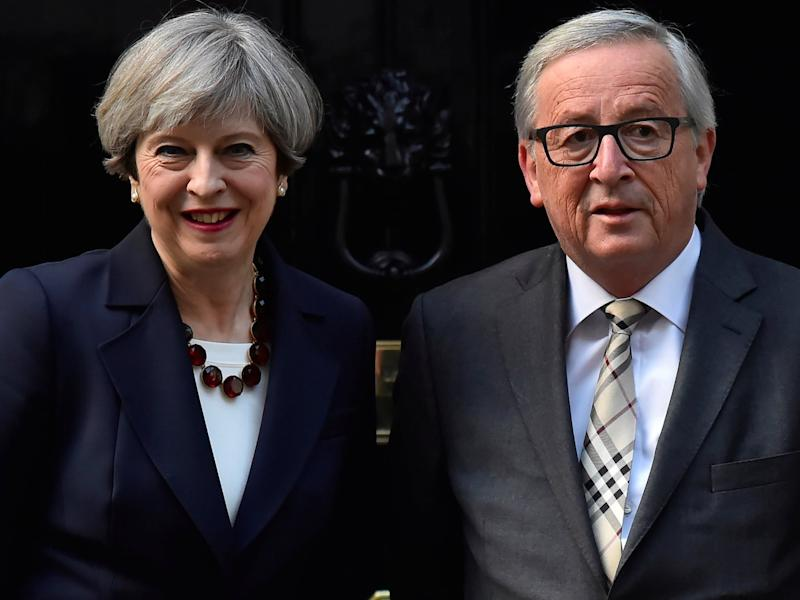 Britain's Prime Minister Theresa May welcomes European Commission President Jean-Claude Juncker to Downing Street in London, Britain April 26, 2017.