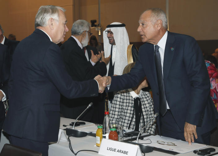 <p> French Minister of Foreign Affairs Jean-Marc Ayrault, left, shakes hands with Arab League Secretary General Ahmed Aboul-Gheit at the opening of the Mideast peace conference in Paris, Sunday, Jan. 15, 2017. Fearing a new eruption of violence in the Middle East, more than 70 world diplomats gathered in Paris on Sunday to push for renewed peace talks that would lead to a Palestinian state. (Thomas Samson/Pool Photo via AP) </p>