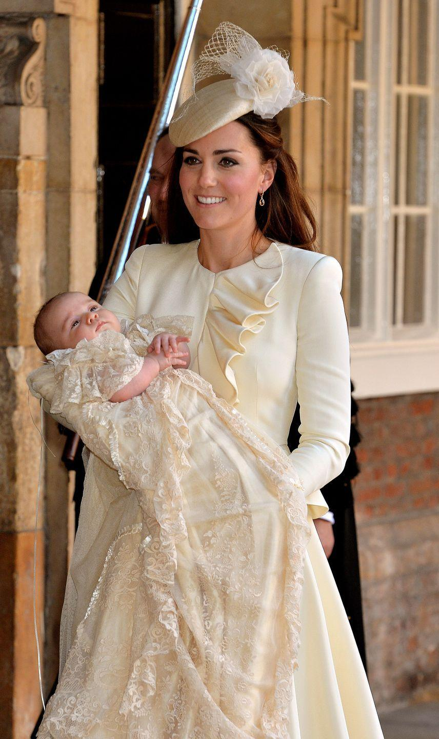 <p>For George's christening in at St. James's Palace in London, Kate first wore this cream-colored Alexander McQueen dress with ruffled detailing down the bodice. </p>