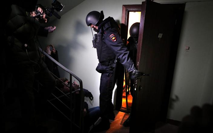 Policemen leave the flat of opposition leader Alexei Navalny in Moscow on January 27 - SERGEI ILNITSKY/EPA-EFE/Shutterstock