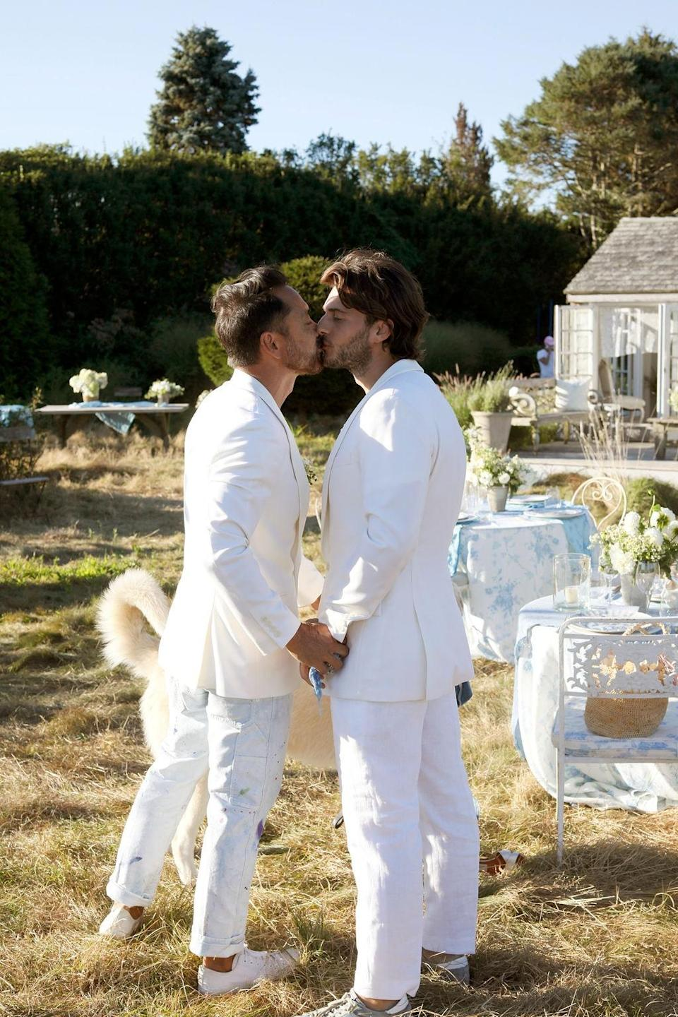 """""""After dancing our way back up the aisle, we stopped for one more kiss,"""" Nicholas says. """"A 'can you believe it?!"""" moment with our little family."""""""