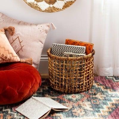 <p>This <span>Banana Bark Round Open Weave Basket</span> ($20) will store all your magazines or blankets and make your space look good and tidy while it's at it.</p>