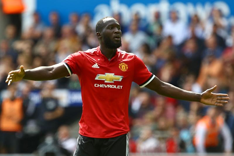 Manchester United's striker Romelu Lukaku celebrates scoring the team's second goal during the English Premier League football match against Swansea City August 19, 2017