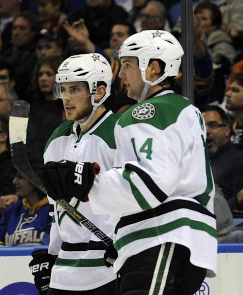 Dallas Stars center Tyler Seguin, left, celebrates a goal by center Jamie Benn, right, during the second period of an NHL hockey game against the Buffalo Sabres in Buffalo, N.Y., Monday, Oct. 28, 2013. (AP Photo/Gary Wiepert)