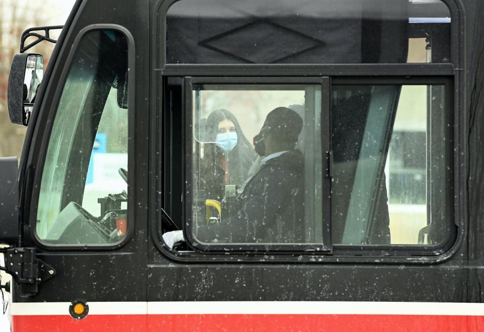 """<span class=""""caption"""">People wearing protective masks board a city transit bus during the COVID-19 pandemic in Toronto on Feb. 19, 2021. </span> <span class=""""attribution""""><span class=""""source"""">THE CANADIAN PRESS/Nathan Denette</span></span>"""