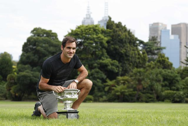 Tennis - Australian Open - Melbourne, Australia, January 29, 2018. Roger Federer of Switzerland poses with the men's singles trophy during the winner's photoshoot at the government house in Melbourne, Australia. REUTERS/Edgar Su