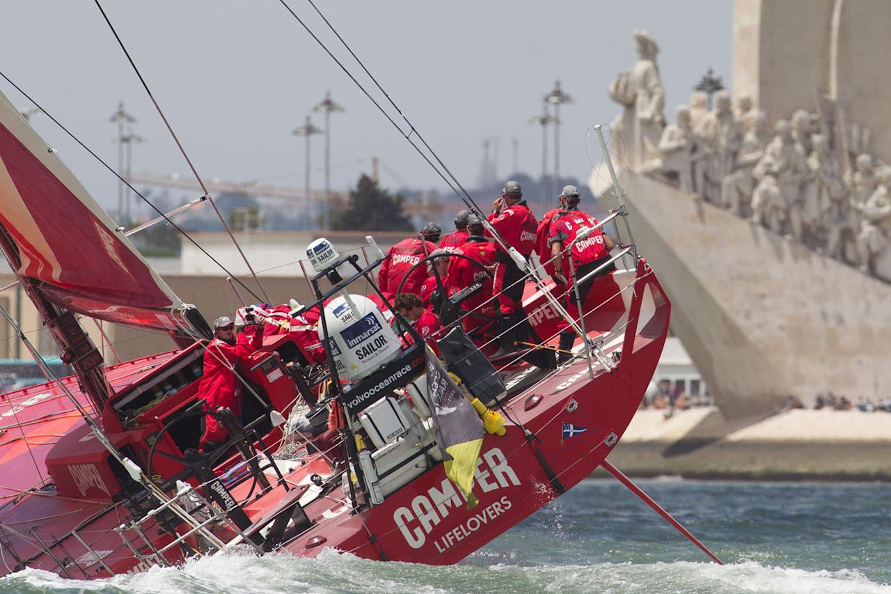 In this photograph provided by the Volvo Ocean Race, shows Camper with Emirates Team New Zealand and skippered by Chris Nicholson from Australia, sailing past the monument to the Discoveries at the start of leg 8 of the Volvo Ocean Race 2011-12 from Lisbon, Portugal, to Lorient, France, on Sunday, June 10, 2012. (AP Photo/Ian Roman/Volvo Ocean Race)