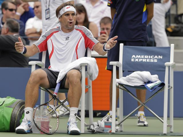 Spain's David Ferrer comments between games against Serbia's Janko Tipsarevic in the quarterfinals during the 2012 US Open tennis tournament, Thursday, Sept. 6, 2012, in New York. (AP Photo/Peter Morgan)