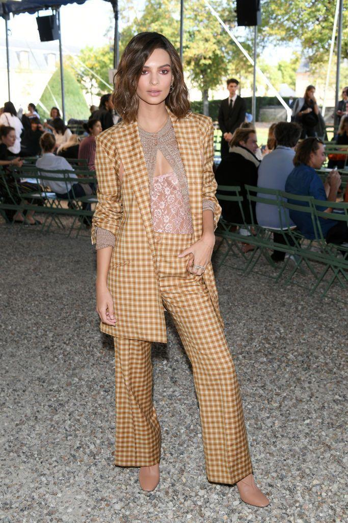 <p>Emily Ratajkowski made quite the appearance at Nina Ricci's Womenswear spring/summer show. Her menswear-inspired plaid suit is juxtaposed with the delicate lace top underneath.<br></p>