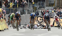 Slovakia's Peter Sagan, left, crashes with Australia's Caleb Ewan, right, during the sprint towards the finish line of the third stage of the Tour de France cycling race over 182.9 kilometers (113.65 miles) with start in Lorient and finish in Pontivy, France, Monday, June 28, 2021. (Benoit Tessier/Pool Photo via AP)