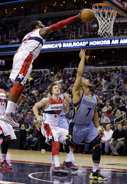 Washington Wizards guard John Wall (2) blocks a shot by Memphis Grizzlies guard Jerryd Bayless (7), with Washington Wizards forward Jan Vesely (24), from the Czech Republic, nearby, in the first half of an NBA basketball game Monday, March 25, 2013 in Washington. (AP Photo/Alex Brandon)