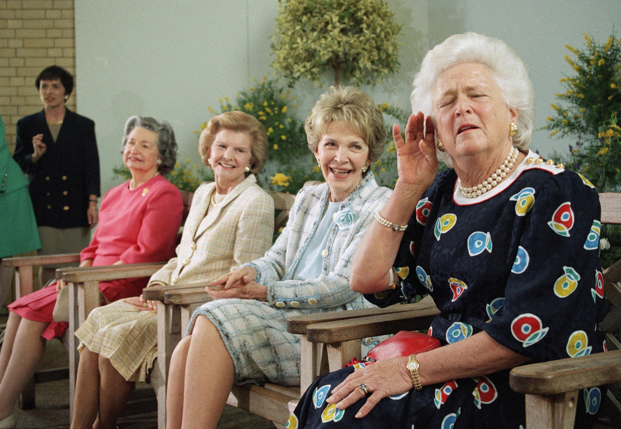 FILE - In this May 11, 1994, file photo, former first lady Barbara Bush, right, playfully strains to hear a reporter's question while posing with other former first ladies, at the U.S. Botanic Garden in Washington. Joining Barbara Bush, from left are; Lady Bird Johnson, Betty Ford and Nancy Reagan. A family spokesman said Tuesday, April 17, 2018, that former first lady Barbara Bush has died at the age of 92. (AP Photo/Denis Paquin, File)
