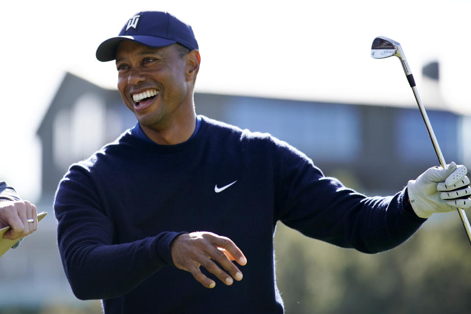 Tiger Woods smiles after hitting his tee shot on the 16th hole during the Genesis Invitational pro-am golf event at Riviera Country Club, Wednesday, Feb. 12, 2020, in the Pacific Palisades area of Los Angeles. (AP Photo/Ryan Kang)