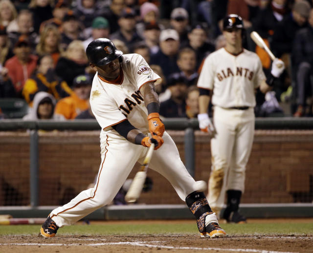 San Francisco Giants' Pablo Sandoval drives in a run with a single against the Los Angeles Dodgers during the seventh inning of a baseball game on Wednesday, April 16, 2014, in San Francisco. (AP Photo/Marcio Jose Sanchez)