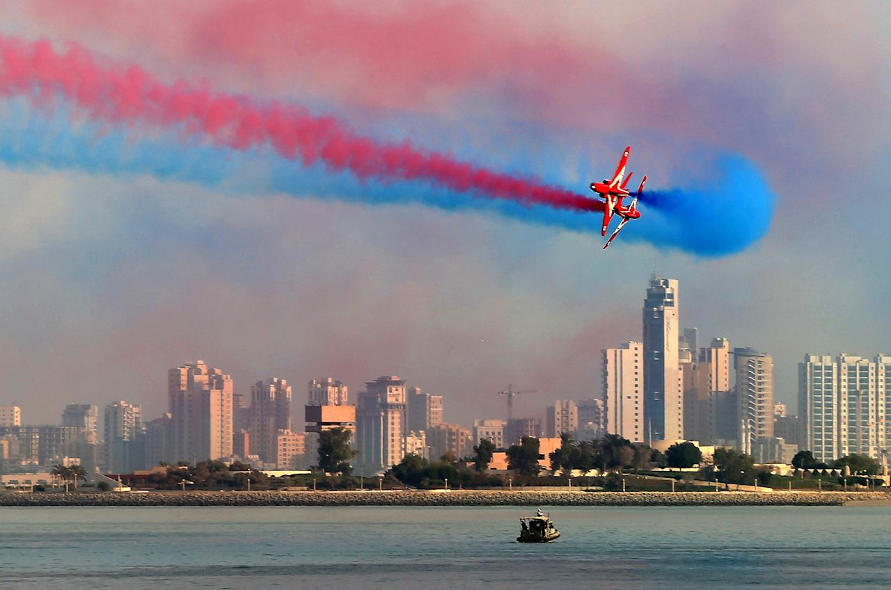 <p>The RAF aerobatic team, the 'Red Arrows', performs aerial manoeuvres during an airshow in Kuwait City (AFP/Yasser Al-Zayyat) </p>
