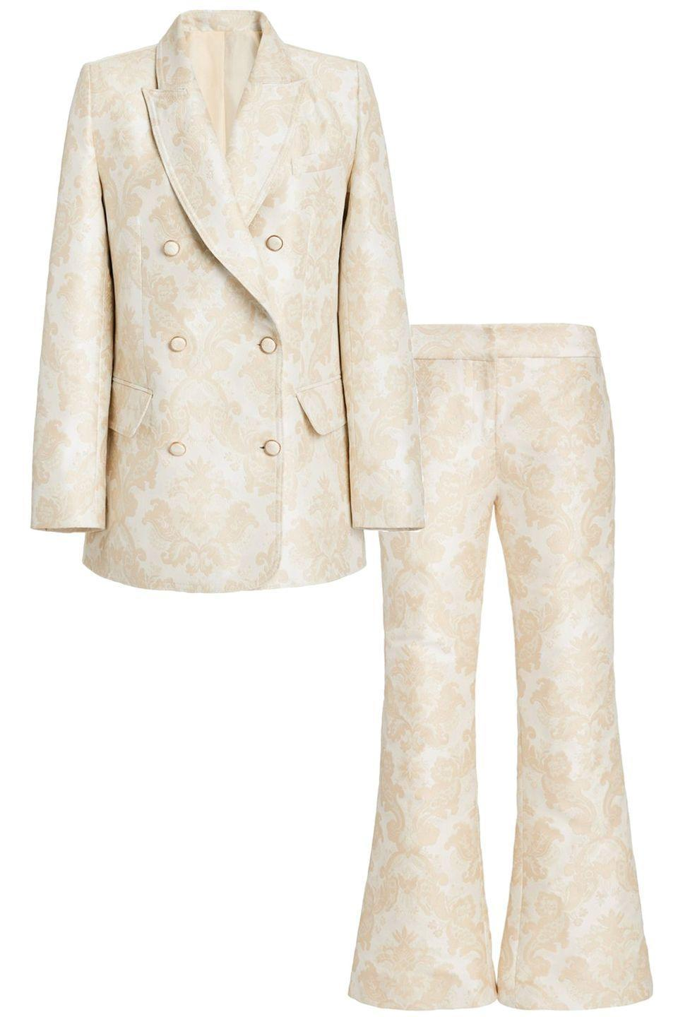 """<p>Known for their flowing floral dresses, Zimmermann does a great suit as well. The subtle golden brocade makes it feel extra special. </p><p><br><a href=""""https://go.skimresources.com?id=74968X1525087&xs=1&url=https%3A%2F%2Fwww.modaoperandi.com%2Fwomen%2Fp%2Fzimmermann%2Fcharm-double-breasted-blazer%2F435174"""" rel=""""nofollow noopener"""" target=""""_blank"""" data-ylk=""""slk:Zimmermann Blazer"""" class=""""link rapid-noclick-resp""""><br>Zimmermann Blazer</a><a href=""""https://go.skimresources.com?id=74968X1525087&xs=1&url=https%3A%2F%2Fwww.modaoperandi.com%2Fwomen%2Fp%2Fzimmermann%2Fcharm-brocade-flare-pants%2F435176"""" rel=""""nofollow noopener"""" target=""""_blank"""" data-ylk=""""slk:Zimmermann Pant"""" class=""""link rapid-noclick-resp""""><br>Zimmermann Pant</a></p>"""