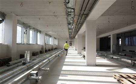 A worker walks down the hallway of the new NATO headquarters, currently under construction in Brussels November 13, 2013. REUTERS/Virginia Mayo/Pool